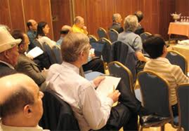 The audience paying rapt attention to the speaker at a conference.