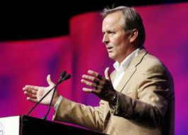 The popular author, John Grisham, giving a conference speech. Possibly telling us about the big fish he caught.